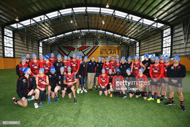 Bombers legend Neale Daniher poses with Bombers players during a cheque presentation to fight MND at the Essendon Football Club on June 5 2017 in...