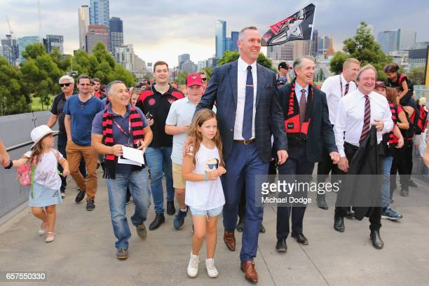 Bombers legends Paul Salmon Terry Daniher and Kevin Sheedy join the Walk To The MCG during the round one AFL match between the Essendon Bombers and...