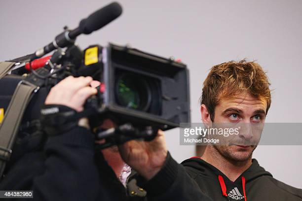 Bombers player Jobe Watson looks on as James Hird speaks to the media following his resignation as head coach of the Essendon Bombers AFL Football...