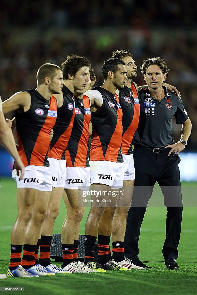 Bombers players and coach James Hird line up for the anthem before the round one AFL match between the Adelaide Crows and the Essendon Bombers at AAMI Stadium on March 22, 2013 in Adelaide, Australia.
