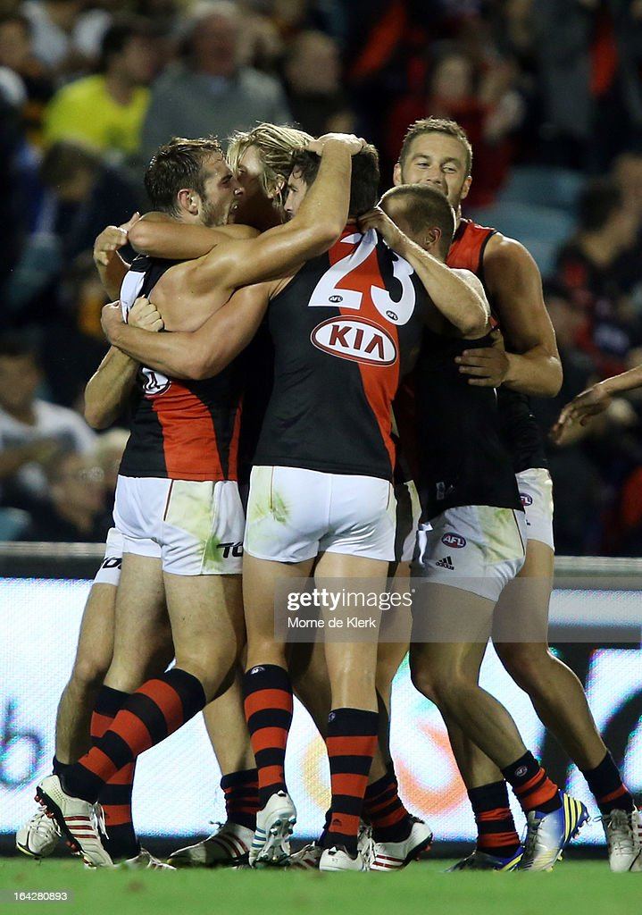 Bombers players celebrate after a goal by Jobe Watson during the round one AFL match between the Adelaide Crows and the Essendon Bombers at AAMI Stadium on March 22, 2013 in Adelaide, Australia.