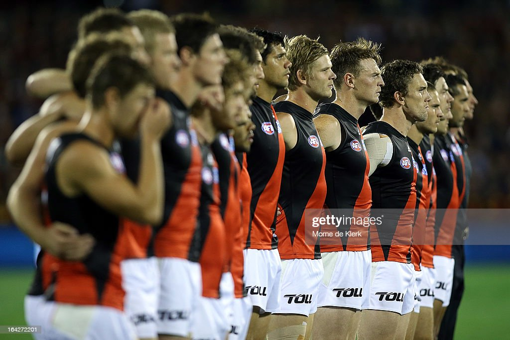 Bombers players including Brendon Goddard lines up for the anthem before the round one AFL match between the Adelaide Crows and the Essendon Bombers at AAMI Stadium on March 22, 2013 in Adelaide, Australia.
