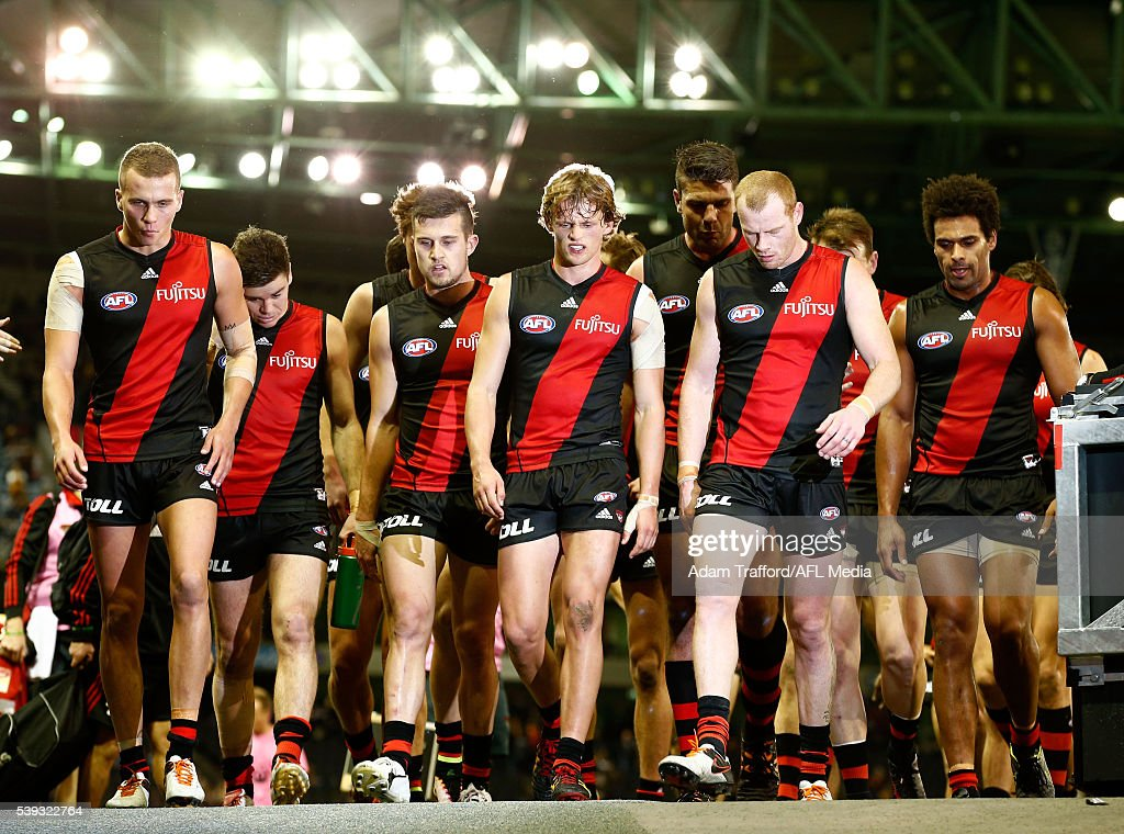Bombers players leave the field at half time during the 2016 AFL Round 12 match between the Essendon Bombers and the Hawthorn Hawks at Etihad Stadium...