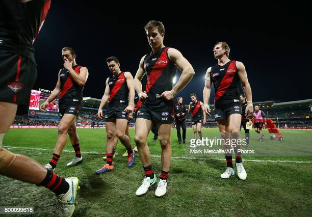 Bombers players look dejected as they walk from the field after defeat in the round 14 AFL match between the Sydney Swans and the Essendon Bombers at...