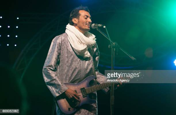 Bombino a member of Nigerian Muhtar Gomara music band performs during the 14th International Nomads Festival in M'Hamid El Ghizlane town of Zagora...