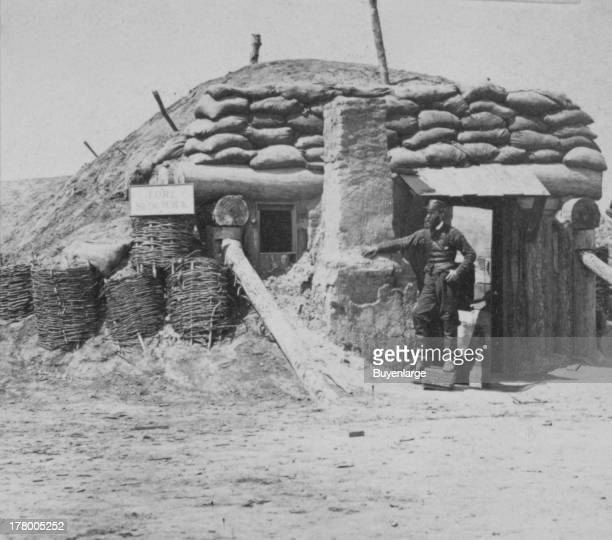 Bombproofs in the Union Fort Sedgwick called by the rebel soldiers 'Fort Hell' Union soldier standing at the entrance of a bombproof structure...