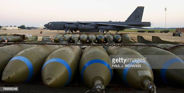 Bombs wait to be loaded on to a B52H long range bomber part of the US Eight Air Force 2nd Bomb Wing fleet 18 September 2007 on the tarmac at...