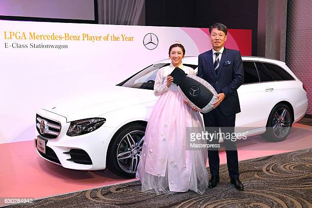 BoMee Lee of South Korea and the representative DirectorPresident CEO at MercedesBenz Japan Kintaro Ueno of Japan pose with the prize in front of...