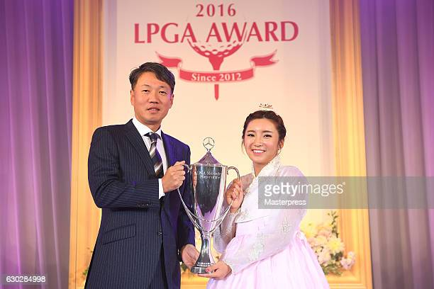 BoMee Lee of South Korea and the representative DirectorPresident CEO at MercedesBenz Japan Kintaro Ueno of Japan pose with the trophy during the...