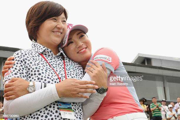 BoMee Lee of South Korea hugs Hiromi Mogi after winning the final round of the CAT Ladies Golf Tournament HAKONE JAPAN 2017 at the Daihakone Country...