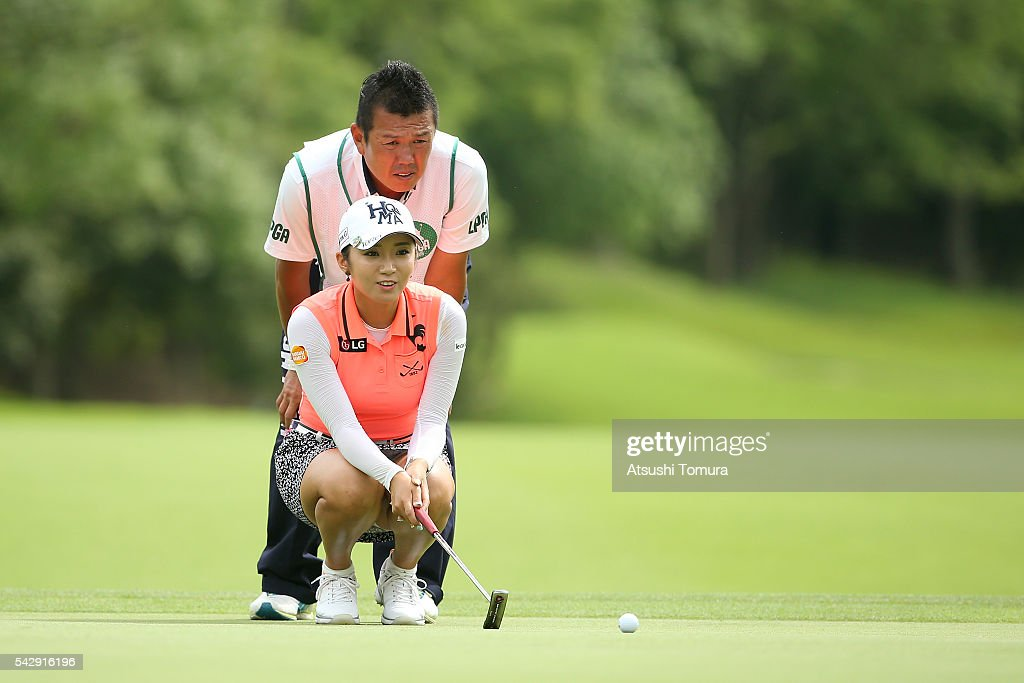 Bo-Mee Lee of South Korea lines up her putt on the 6th green during the third round of the Earth Mondamin Cup at the Camellia Hills Country Club on June 25, 2016 in Sodegaura, Japan.