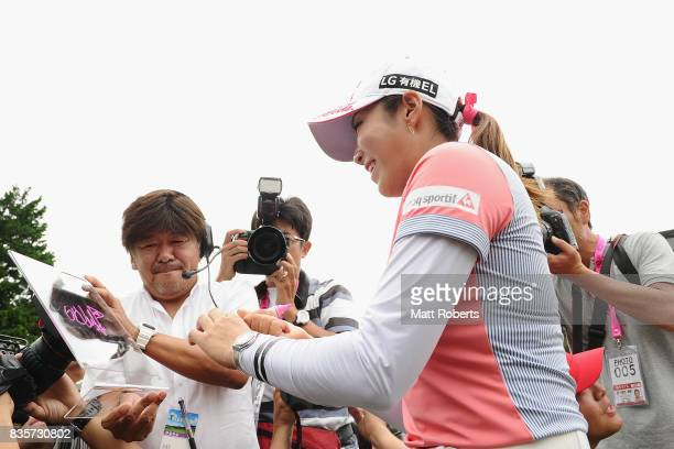 BoMee Lee of South Korea poses for a television camera after winning the final round of the CAT Ladies Golf Tournament HAKONE JAPAN 2017 at the...