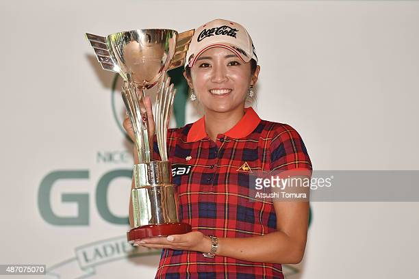 BoMee Lee of South Korea poses with the trophy after winning the Golf 5 Ladies Tournament 2015 at the Mizunami Country Club on September 6 2015 in...