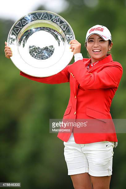 BoMee Lee of South Korea poses with the trophy after winning the Earth Mondamin Cup at the Camellia Hills Country Club on June 28 2015 in Sodegaura...