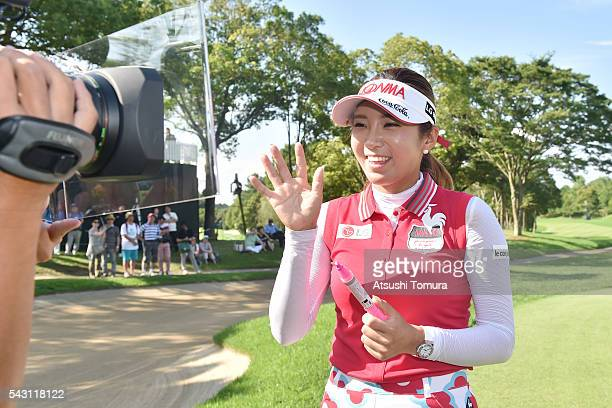 BoMee Lee of South Korea signs an autograph on the TV camera after winning the Earth Mondamin Cup at the Camellia Hills Country Club on June 25 2016...