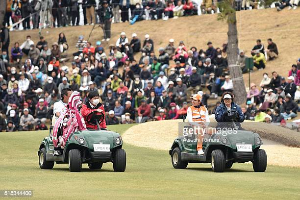 BoMee Lee of South Korea sits in golf carts as she is driven to the 18th tee for a playoff during the final round of the Yokohama Tire PRGR Ladies...