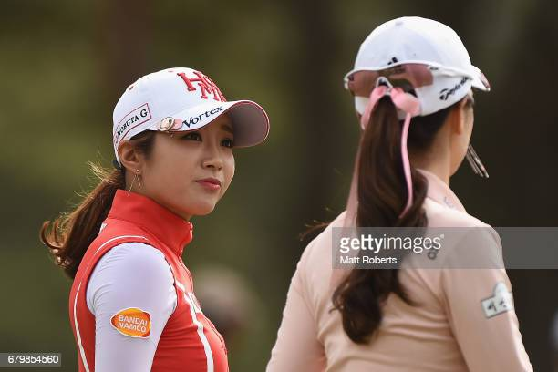 BoMee Lee of South Korea speaks with ShinAe Ahn of South Korea on the 1st hole during the final round of the World Ladies Championship Salonpas Cup...