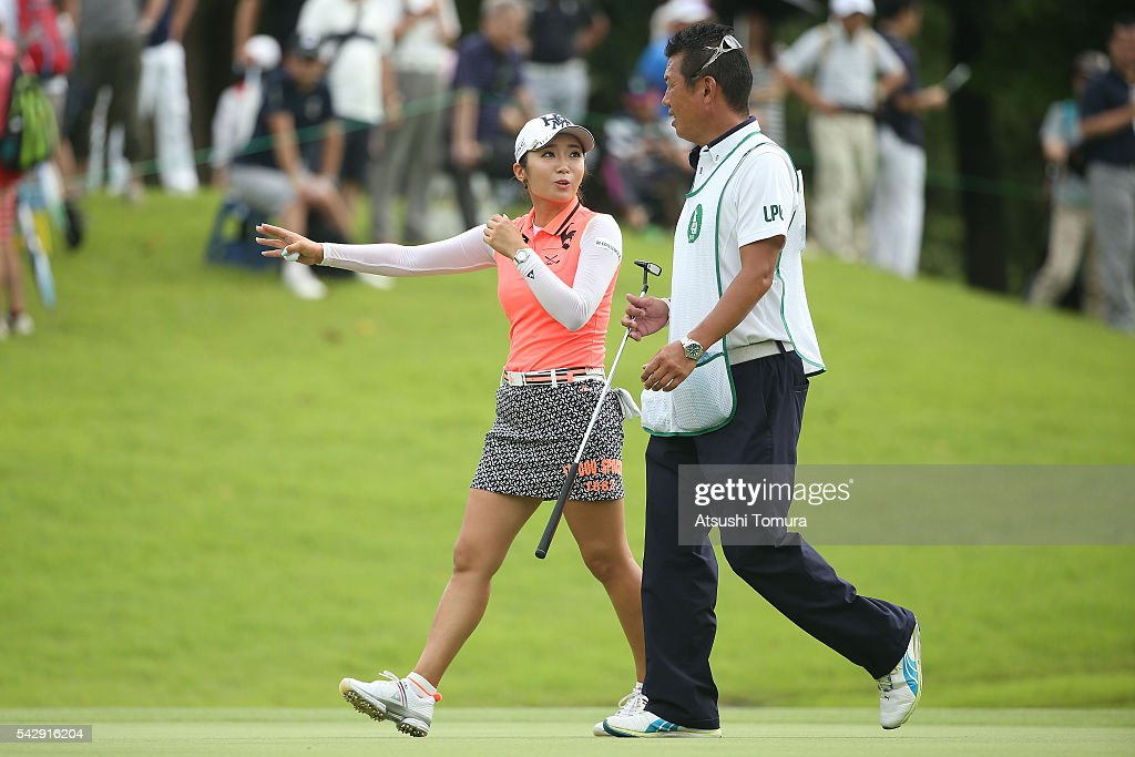 Bo-Mee Lee of South Korea talks to her caddie during the third round of the Earth Mondamin Cup at the Camellia Hills Country Club on June 25, 2016 in Sodegaura, Japan.