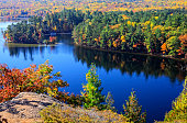 Scenic view of Bon Echo Provincial Park with beautiful fall colors and blue lake.