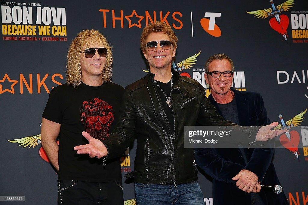 Bon Jovi members David Bryan (L) Jon Bon Jovi (C) and Tico Torres pose for the media at the Crown on December 6, 2013 in Melbourne, Australia.