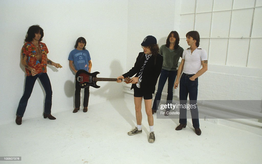 Bon Scott, Malcolm Young, Angus Young, Cliff Williams and Phil Rudd of Australian rock band AC/DC pose in London, England in August 1979.