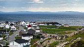 Bonavista, Newfoundland, Canada, on mid summer overcast day.   Village community alongside the sea.  People staying inside on blustery day.