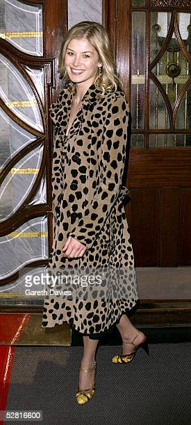 Bond Girl Rosamund Pike arrives at the Opening Night and World Premiere of 'Billy Elliot The Musical' at the Victoria Palace Theatre on May 12 2005...