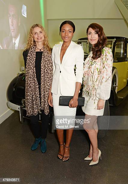 Bond Girls Maryam d'Abo Naomie Harris and Caterina Murino attend the 'Bond In Motion' photocall at the London Film Museum on March 18 2014 in London...