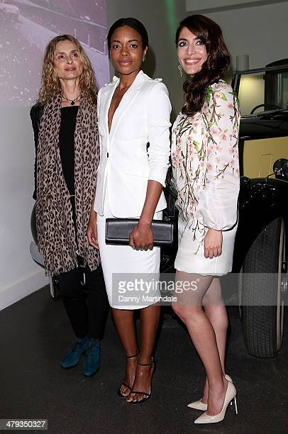 Bond Girls Maryam d'Abo Naomie Harris and Caterina Murino attends a photocall ahead of the opening of the Bond In Motion exhibition at the London...