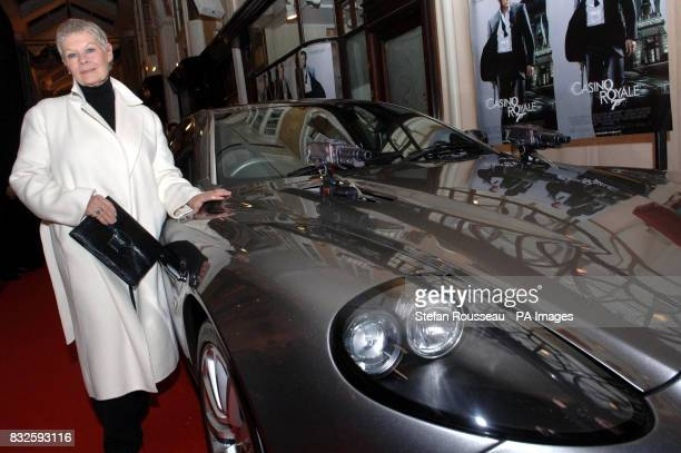 Bond star Dame Judi Dench with a silver Austin Martin Vanquish used in the Bond film Die Another Day at the Burlington Arcade near Piccadilly tonight...
