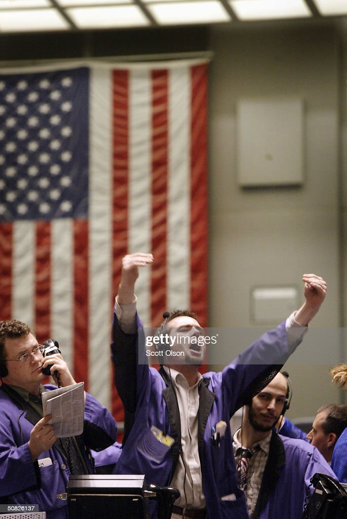 A bond trader signals an offer in the US Treasury 10year T note options pit at the Chicago Board of Trade May 11 2004 in Chicago Illinois Bond prices...