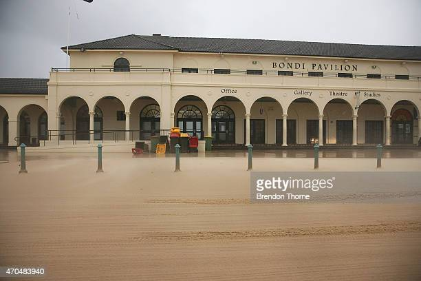 Bondi Pavilion and carpark is covered with sand pushed by strong winds on April 21 2015 in Sydney Australia A second day of damaging winds and heavy...