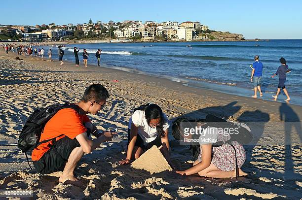 Bondi tourists make a sandcastle as Sydney enjoys a temperature of 22 degrees celsius on July 31 2014 in Sydney Australia Both Sydney and Melbourne...