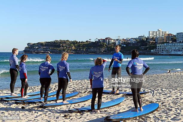 Bondi tourists take surfing lessons as Sydney enjoys a temperature of 22 degrees celsius on July 31 2014 in Sydney Australia Both Sydney and...