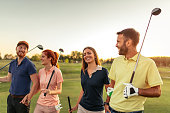 Group of friends walking on the golf course