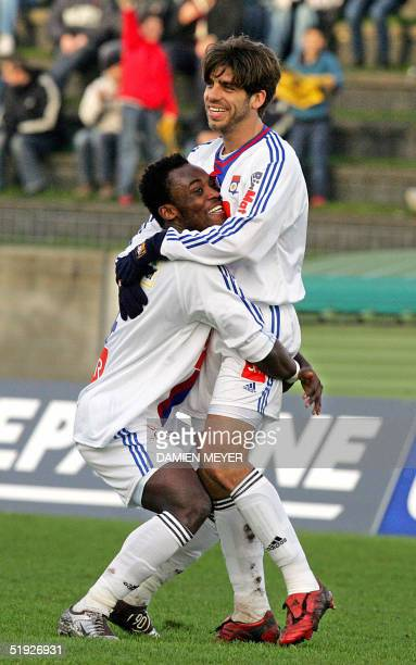 Lyon's Brazilian midfielder Juninho is congratuled by his teammate Ghanaian mifielder Mickael Essien after he scored a goal during their French Cup...