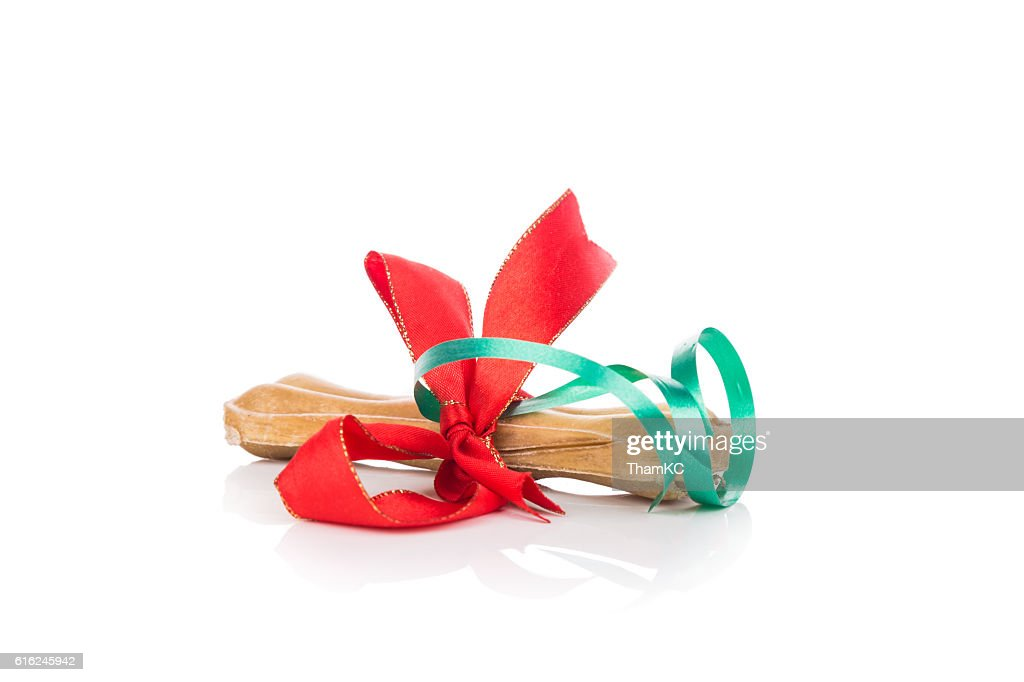 Bone Christmas gift wrapped with green and red ribbon : Stock Photo