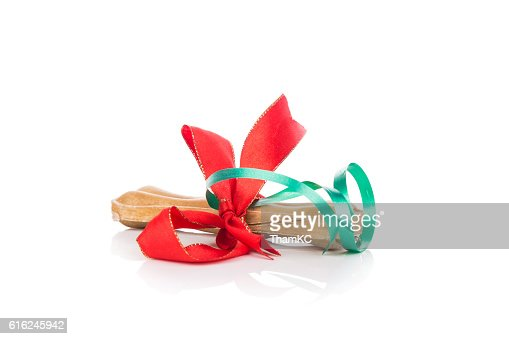 Bone Christmas gift wrapped with green and red ribbon : Foto de stock