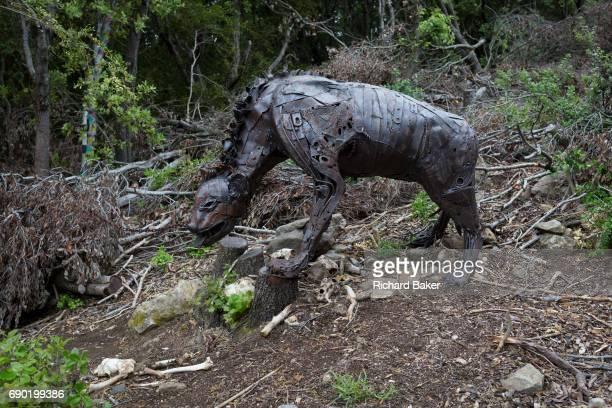 Bones including skulls beneath the fantasy animal artwork entitled 'Belbeth on the Ground' by Colin Castell et Sébastien Garibaldi on the sculpture...