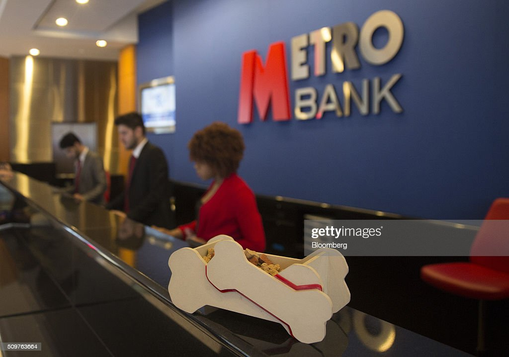A bone-shaped container containing dog biscuits sits on the counter inside a branch of Metro Bank Plc in London, U.K., on Friday, Feb. 12, 2016. Metro Bank, the British lender backed by wealthy American financiers including Steven Cohen, plans to sell shares to existing investors before going public on the London Stock Exchange. Photographer: Simon Dawson/Bloomberg via Getty Images