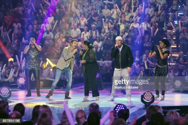 Boney M feat Liz Mitchell Austrian singer DJ Atzi and Florian Silbereisen perform during the show 'Schlagercountdown Das grosse Premierenfest' at EWE...