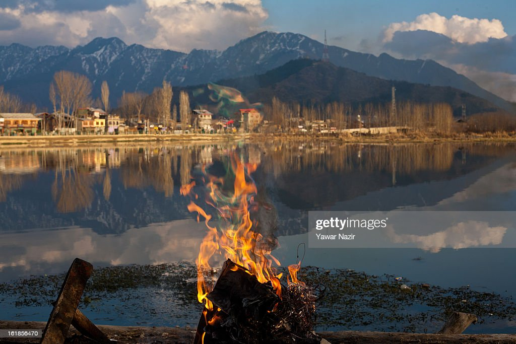 A bonfire is seen on the banks of Brari Numbal Lagoon during a strike call given by separatists against the execution of alleged Indian parliament attacker Mohammad Afzal Guru on February 17, 2013 in Srinagar, the summer capital of Indian Administered Kashmir, India. Normal life remains affected in Indian-administered Kashmir for the ninth consecutive day as a complete shutdown was observed on the call of separatist leader Syed Ali Shah Geelani. Afzal Guru was hanged on February 9 for his alleged role in the 2001 Indian parliament attack which left 14 dead. Clashes between Kashmiri youth and Indian police were also reported in several parts of the disputed Himalayan region, which was put under a strict curfew for a week by Indian authorities worried about massive public protests following Guru's hanging last Saturday.