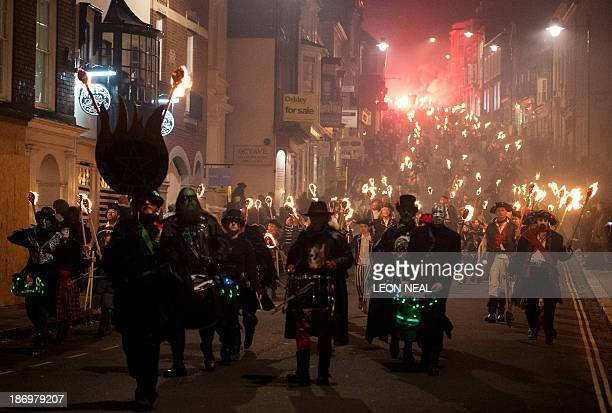 Bonfire societies parade through the streets during the Bonfire Night celebrations on November 5 2013 in Lewes Sussex in England Bonfire Night is...