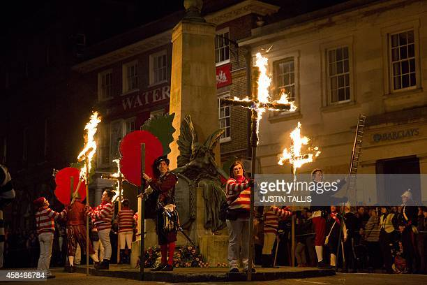 Bonfire societies stop at a memorial as they parade through the streets of Lewes in Sussex on November 5 during the traditional Bonfire Night...