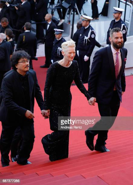 Bong Joonho Tilda Swinton and Sandro Kopp attend the 70th Anniversary of the 70th annual Cannes Film Festival at Palais des Festivals on May 23 2017...