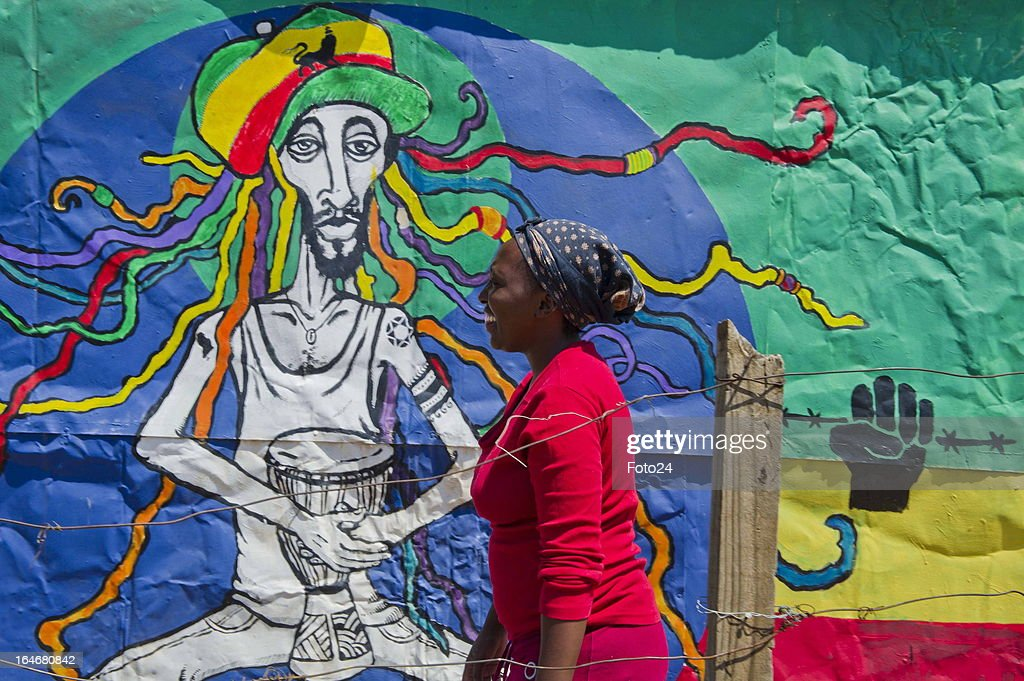 Bongi Bota stands outside of one of the painted shacks on March 24, 2013 in Mamelodi, South Africa. The Viva Foundation hosted the second Mams Art Festival at the informal settlement over the weekend. The art festival focuses on creating the world's first living art gallery by transforming shacks into art work.