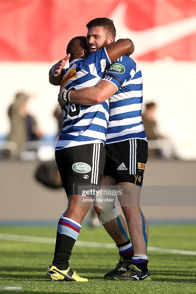 Bongi Mbonambi of DHL Western Province embraces teammate Jaco Taute after he scored a try during the match between Saracens and DHL Western Province...