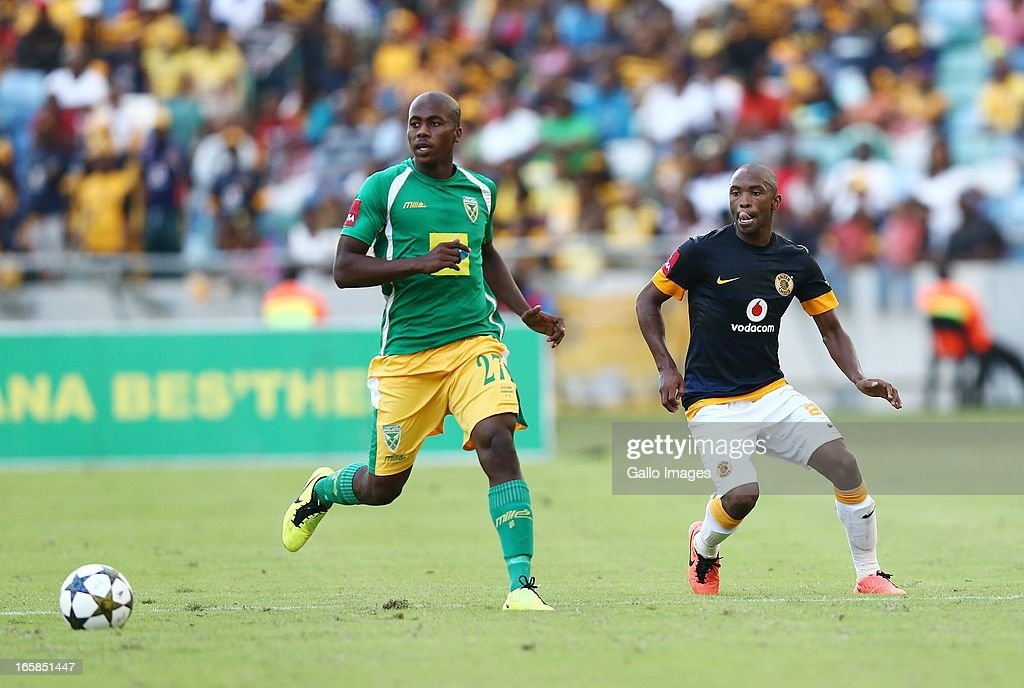Bonginkosi Ntuli and Bernard Parker (R) during the Absa Premiership match between Golden Arrows and Kaizer Chiefs at Moses Mabhida Stadium on April 06, 2013 in Durban, South Africa.