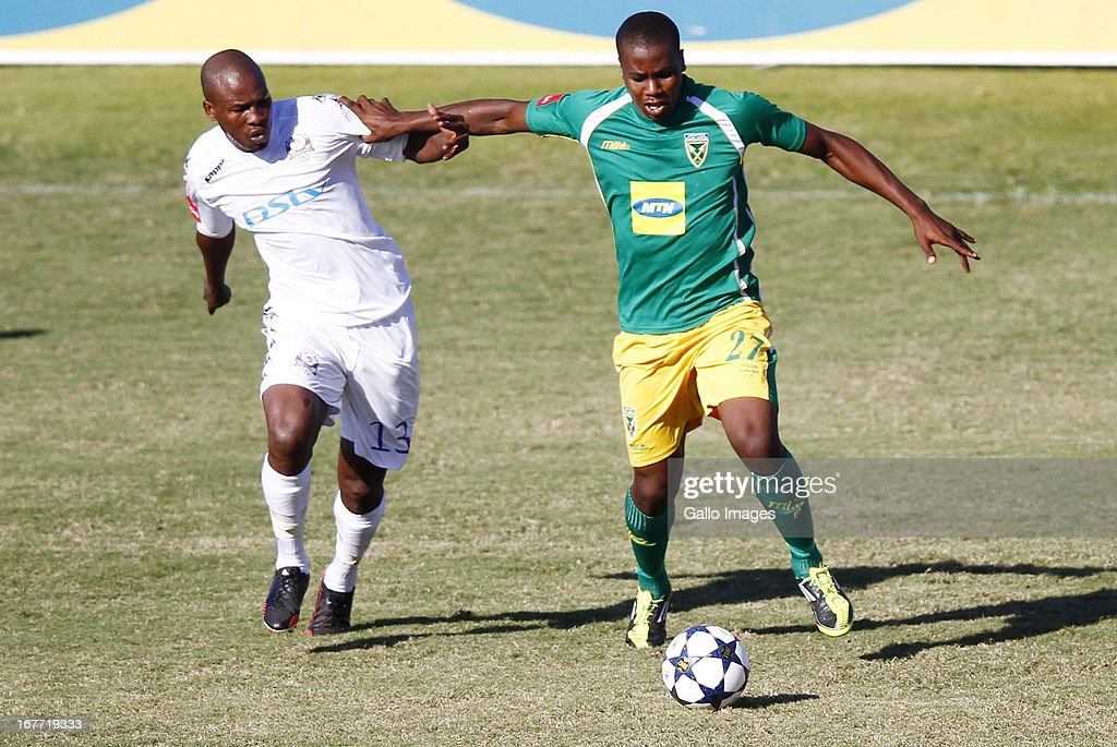 Bonginkosi Ntuli holds off Innocent Mdledle during the Absa Premiership match between Golden Arrows and SuperSport United at Princess Magogo Stadium on April 28, 2013 in Durban, South Africa.
