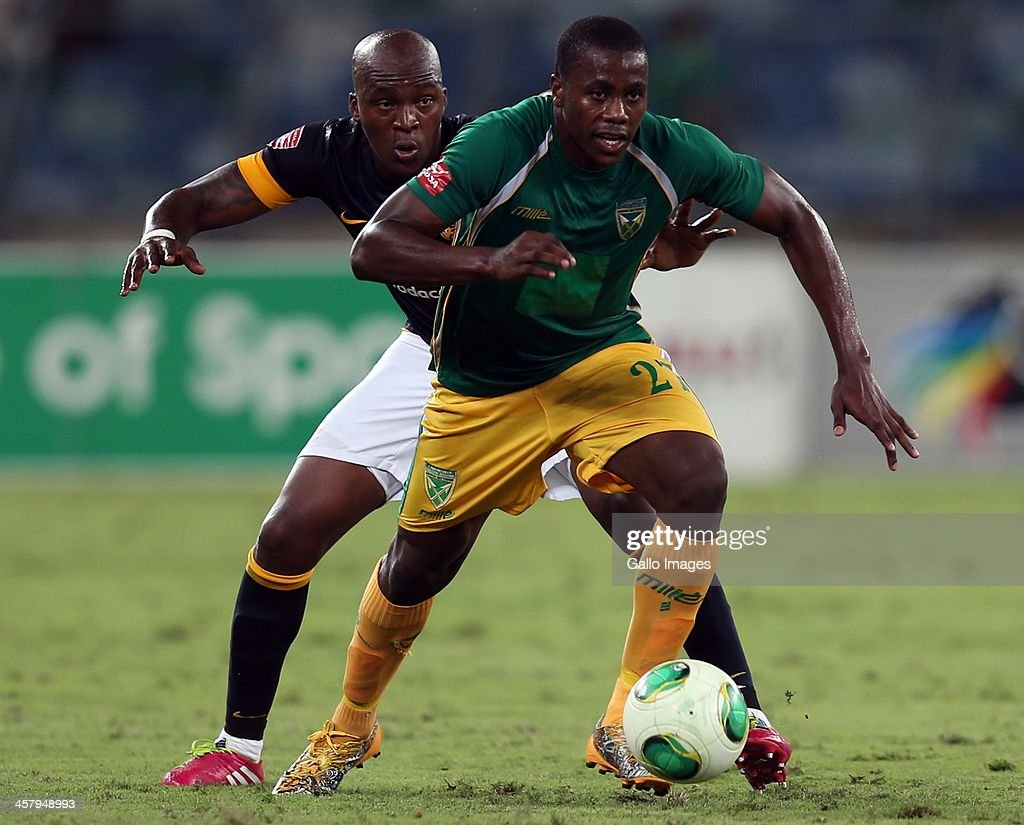 Bonginkosi Ntuli of Lamontville Golden Arrows holds off Morgan Gould of Kaizer Chiefs during the Absa Premiership match between Golden Arrows and Kaizer Chiefs at Moses Mabhida Stadium on December 19, 2013 in Durban, South Africa.